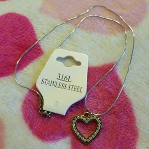 authentic coach heart charm on a necklace